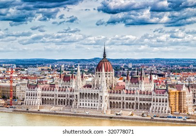 Panorama of the Parliament and the Danube river running through the ancient buildings of Budapest
