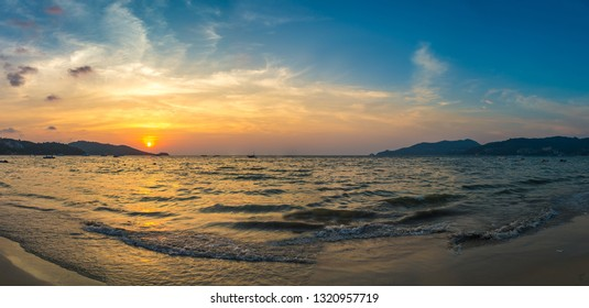 Panorama of Patong beach and Andaman sea on Phuket in Thailand during sunset