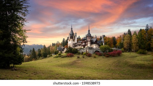 Panorama of Peles Castle, Romania. Beautiful famous royal castle and ornamental garden in Sinaia landmark of Carpathian Mountains in Europe at sunset. Former Home Of The Romanian Royal Family.