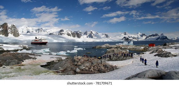 Panorama - penguin colonies, cruise ship & tourists, Petermann Island,Antarctica