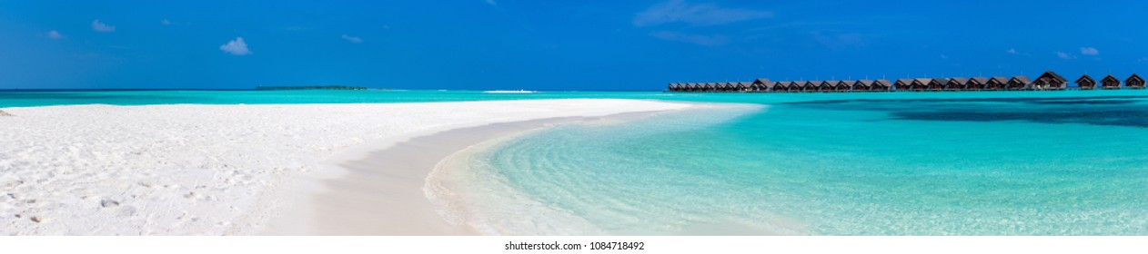 Panorama of perfect white sand beach and turquoise tropical ocean in Maldives