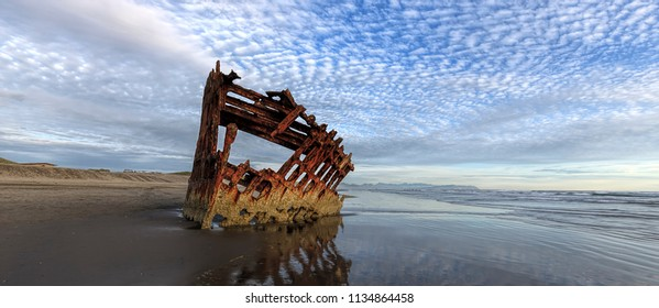 A panorama of the Peter Iredale shipwreck near Astoria Oregon taken near sunset.