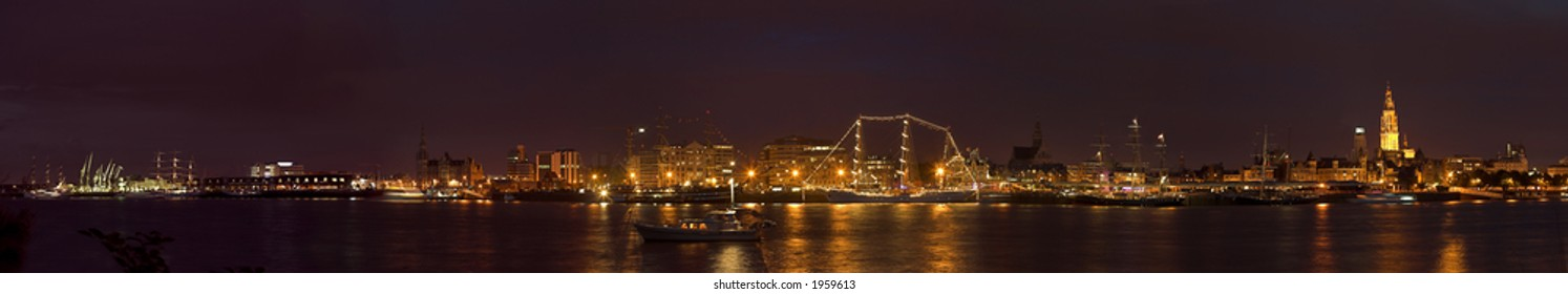 Panorama photo of the city of Antwerp, at night, during the 50th Tall Ships Race in 2006