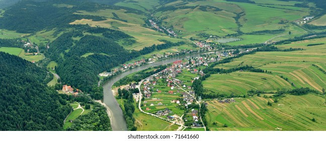 panorama photo of Dunajec river dividing Poland and Slovak republik. Red Cloister (slovak: Cerveny klastor) in picture. Photo taken from Three Crowns hills.