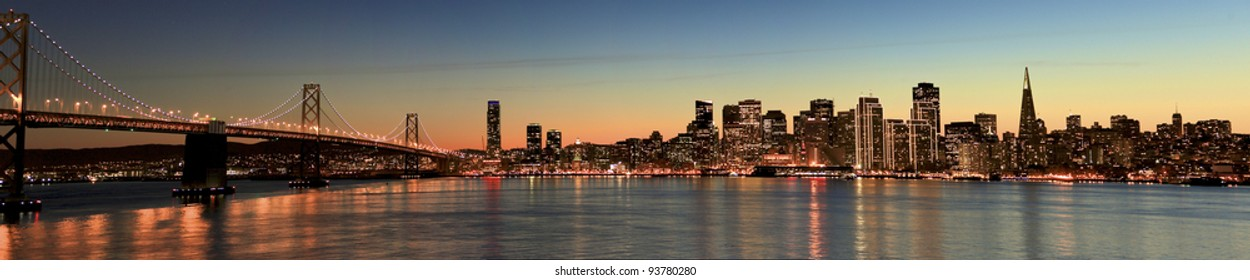 Panorama  photo of the San Francisco bay bridge and the city of SF.shot in the evening