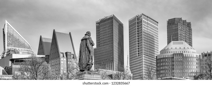 Panorama photo of the statue of William of Orange on het Plein in the Hague with the sky-line in the background in black and white