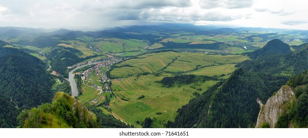 panorama photo taken from famous tourist destination - Three Crowns hills in Poland. Dunajec river dividing Poland and Slovakia in background.