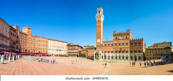 Panorama of Piazza del Campo (Campo square), Palazzo Publico and Torre del Mangia (Mangia tower) in Siena, Tuscany, Italy