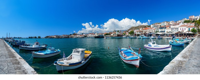 Panorama picture of the harbour with fishing boats in Samos town