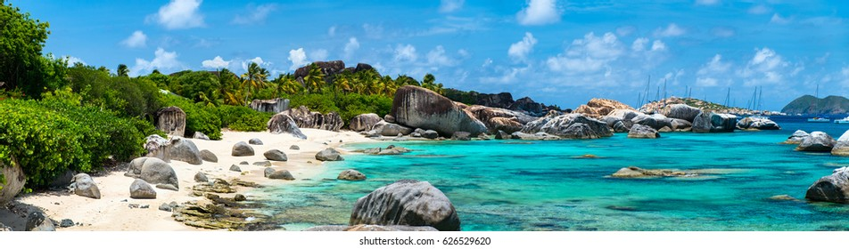 Panorama of a picture perfect beach with white sand, turquoise ocean water and blue sky at British Virgin Islands in Caribbean