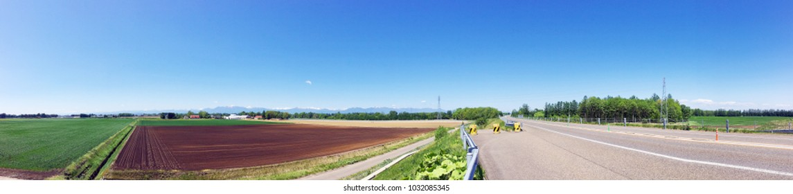 Panorama picture of roadside view both natural and agricultural area along express way in Hokkaido, Japan