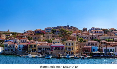 Panorama of picturescue colorful houses on embankment of Chalki Island, one of the Dodecanese islands of Greece, close to Rhodes.