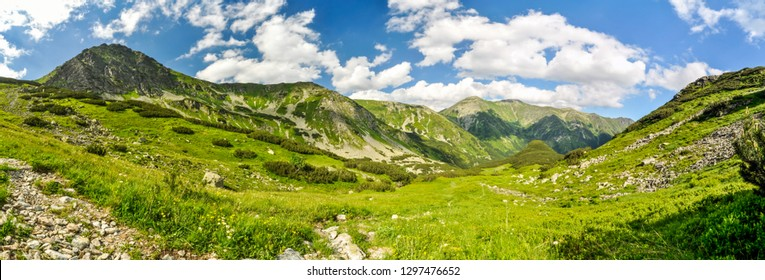 Panorama of picturesque green valley in mountainous landscape of Slovakia on sunny summer day.