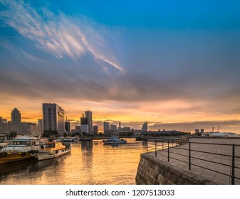 Panorama from Ōsanbashi Pier port where fishing boats are moored and in background the Landmark Tower, the Cosmo Clock 21 Big Wheel, the Pacifico Yokohama National Convention Hall in the Minato Mirai.
