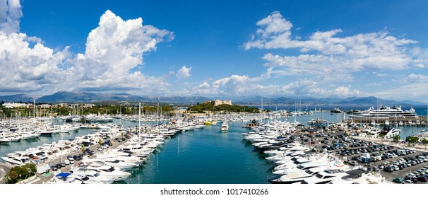 Panorama from Port of Antibes with old fort centered and mountains in background