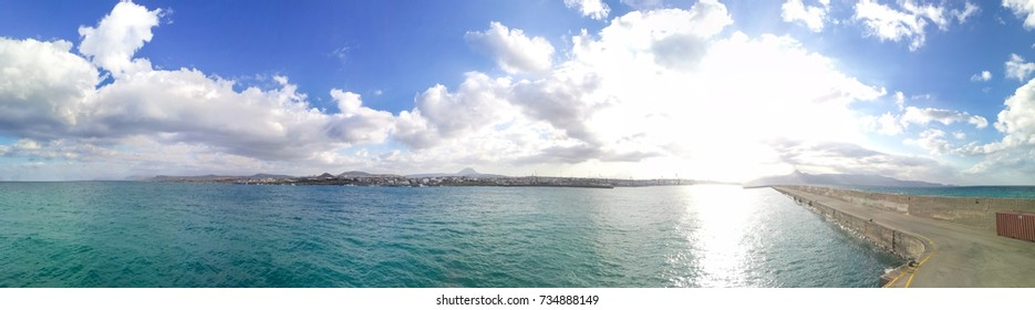 Panorama port Heraklion, Crete. Beautiful Sky with clouds and  rays of the sun.