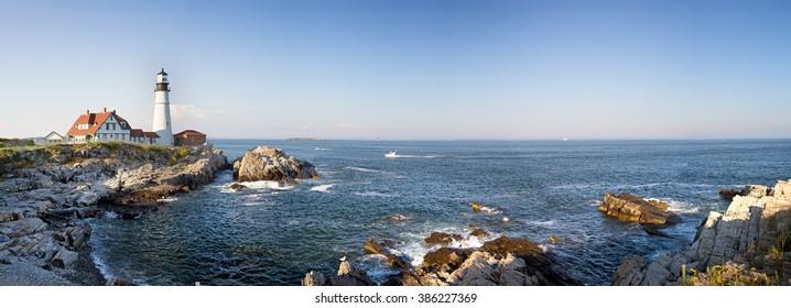 A panorama of the Portland Head lighthouse and rugged coastline, Maine, USA