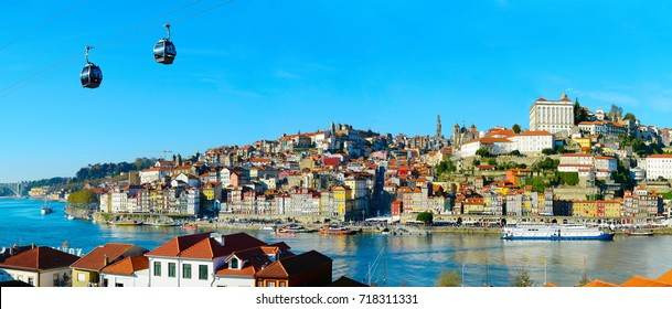 Panorama of Porto with cable car and boats on Douro river. Portugal