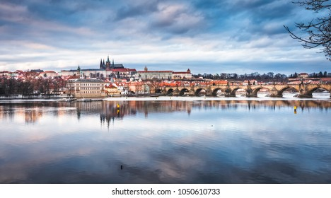 Panorama of Prague Castle and St. Vitus cathedral in twilight with dramatic sky. Prague, Czech Republic