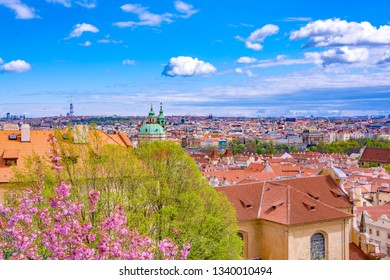Panorama of Prague with traditional red roofs in springtime, Czech Republic