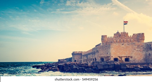 Panorama of Qaitbay Citadel - medieval fortress on Mediterranean sea on the coast of Alexandria, Egypt. Panoramic view on ancient historic landmarks in arabic style with place for your text.