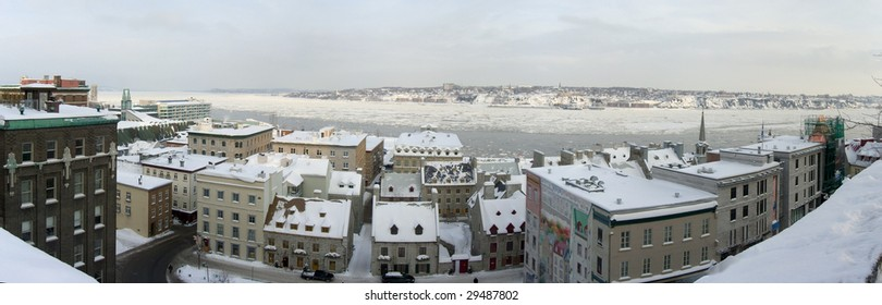 A panorama of Quebec City and the St. Lawrence River in winter