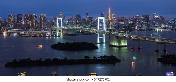 Panorama of Rainbow Bridge at night, Tokyo, Japan
