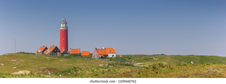 Panorama of the red lighthouse and houses on Texel island, Holland