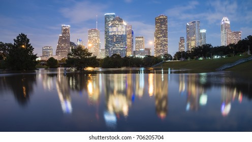 Panorama reflection of Downtown Houston skyscrapers on a pond of overflow water from Bayou River to Eleanor Park after Harvey tropical storm. Heavy rain of hurricane Harvey caused many flooded areas