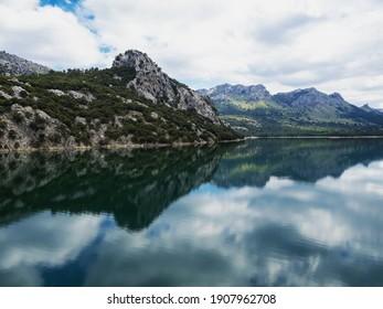 Panorama reflection of Embalse de Gorg Blau artificial lake freshwater reservoir Mallorca Balearic Islands Spain Europe