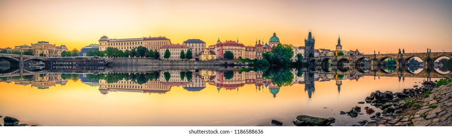 Panorama with reflections of Prague including Old town tower and Charles and Manes bridges