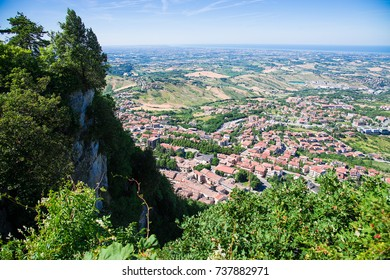 Panorama of Republic of San Marino and Italy from Monte Titano, City of San Marino. City of San Marino is capital city of Republic of San Marino located on Italian peninsula, near Adriatic Sea.