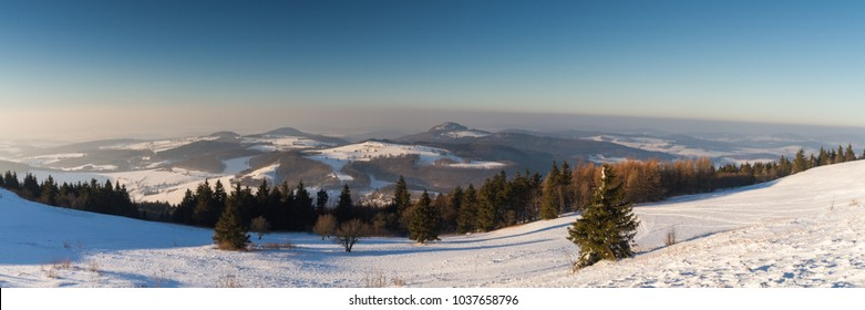 Panorama of the Rhoen in winter as seen from the top of the Wasserkuppe, Hesse, Germany