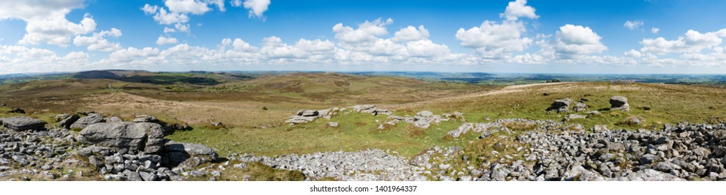 Panorama from Rippon Tor of, from left to right, Emsworthy Rocks, Saddle Tor and Haytor across moorland of Dartmoor National Park, Devon, UK. Teignmouth and Newton Abbot are visible in the background.