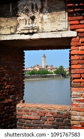 Panorama with river Adige from the bridge of the medieval castle: view of the patron church of Verona, San Zeno, Italy.
