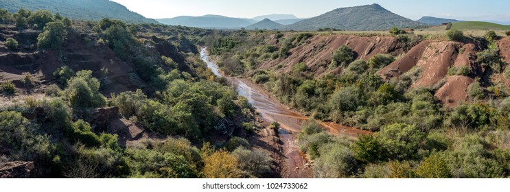 panorama of a river at the bottom of a canyon and its vegetation
