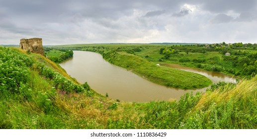 Panorama of river with remains of medieval Zhvanets castle built in the 15th century. Pentagonal stone castle tower, Khmelnytskyi Oblast, Ukraine