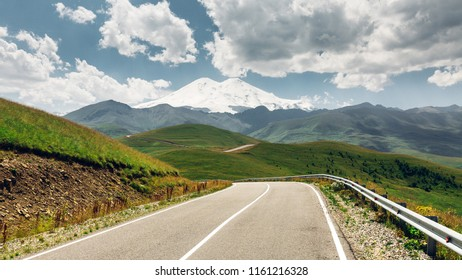 Panorama Road Leading To Mount Elbrus In Summer. North Caucasus, Russia