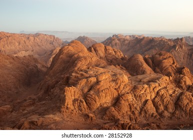 """Panorama rocks of holy ground Mount Sinai in early morning """"And the mountains shall be molten under Him, and the valleys shall be cleft, as wax before the fire..."""" Micah 1:4"""