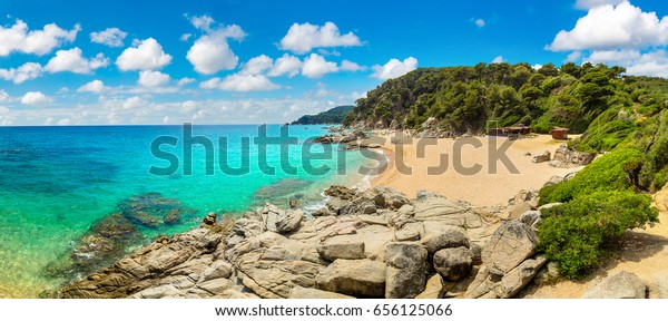 Panorama of Rocks on the coast of Lloret de Mar in a beautiful summer day, Costa Brava, 