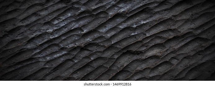 Panorama rough black and brown slate texture background. Panoramic dark black and brown carving slate texture surface