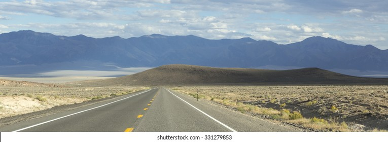 Panorama of Route 50 - the loneliest road in America with background of Mountains and arid landscape, Nevada. USA