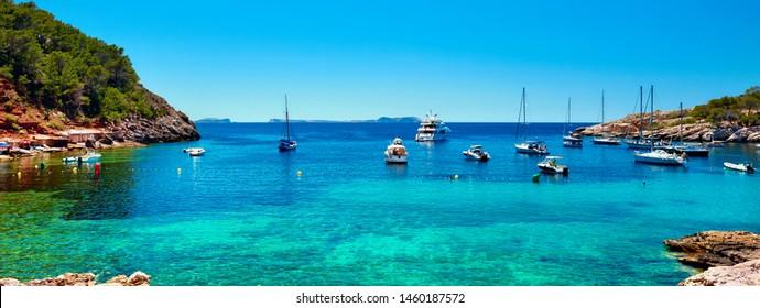 Panorama of sailboats at Cala Salada lagoon. Idyllic scenery. Ibiza, Balearic Islands. Spain