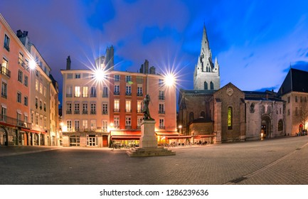 Panorama of Saint Andrew square with Collegiate Church of Saint Andrew at night, Grenoble, France