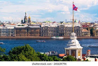 Panorama of Saint Petersburg, Russia. Tourist boats sail on the Neva River. St Petersburg is one of the top travel destinations of Russia. Cityscape of Saint Petersburg with Navy Ensign in summer.