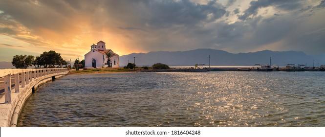 Panorama of Saint Spyridon church in Elafonisos in Greece against the sunset.