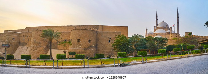 Panorama of Saladin Citadel with preserved medieval wall, huge towers, rising Alabaster mosque and ornamental garden around the complex, Cairo, Egypt.