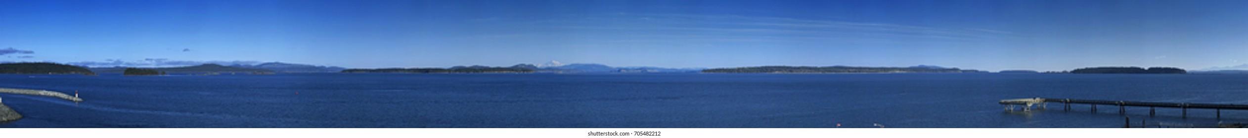 Panorama of the Salish Sea, Gulf Islands, BC, Canada and the San Juan Islands, Mt. Baker and the Cascade Range mountains, WA, USA