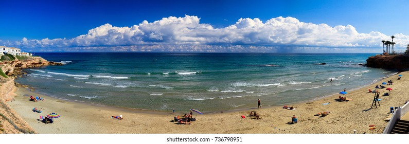 Panorama sandy beach, sea, resort, Spain, summer
