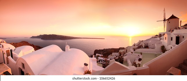 Panorama of Santorini with windmill and sea-view in Greece